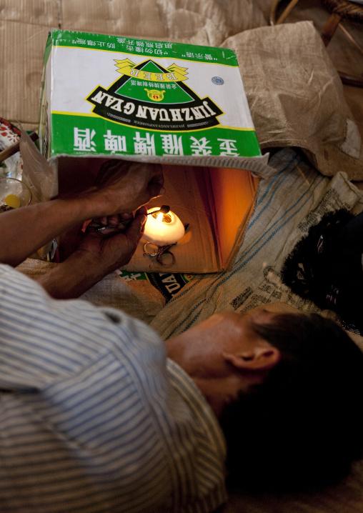 Akha minority man smoking opium, Ban ta mi, Laos