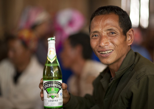Akha minority man drinking beer, Ban ta mi, Laos