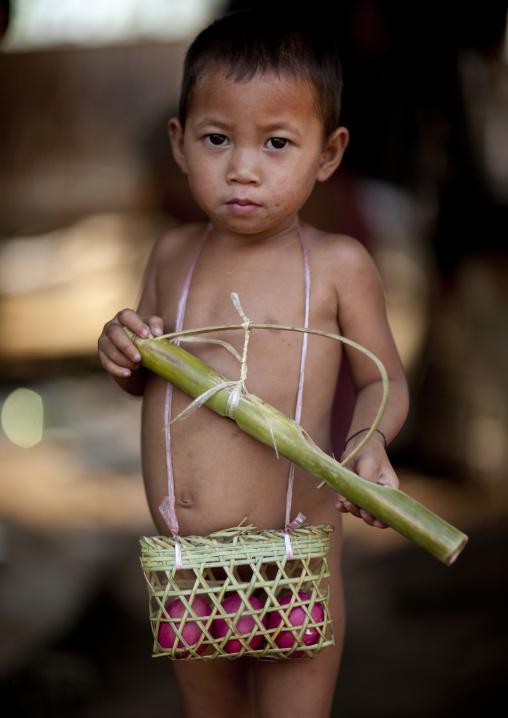 Akha minority boy with a basket of eggs, Muang sing, Laos