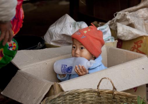 Kid in a market, Muang sing, Laos