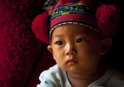 Yao minority kid with traditional hat, Ban xay leck, Laos