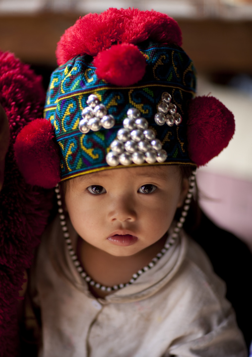 Yao minority kid with a traditional hat, Ban xay leck, Laos