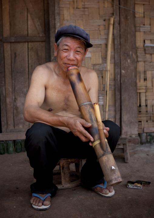 Ho minority shaman smoking, Louang namtha, Laos