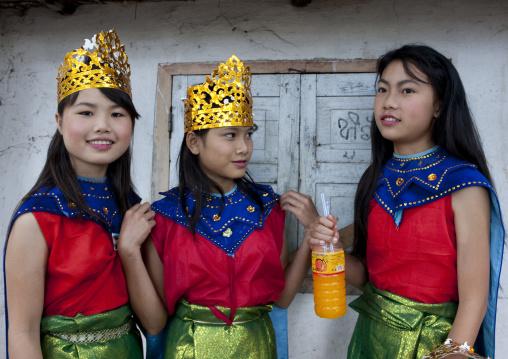 Girls in traditionnal clothing during pii mai lao new year celebration, Luang prabang, Laos