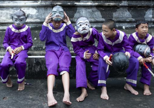 Kids with masks during pii mai lao new year celebration, Luang prabang, Laos