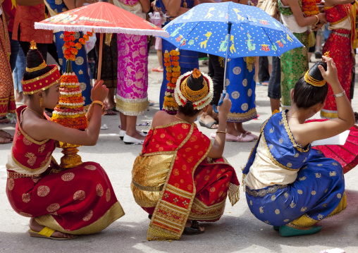 Girl sin traditional clothing during pii mai lao new year celebration, Luang prabang, Laos