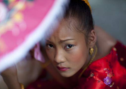 Girl in traditional clothing during pii mai lao new year celebration, Luang prabang, Laos