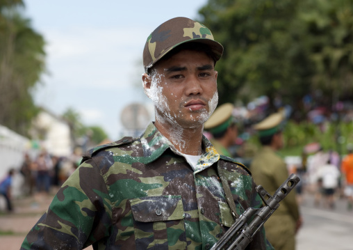 Soldier with flour on the face during pii mai lao new year celebration, Luang prabang, Laos