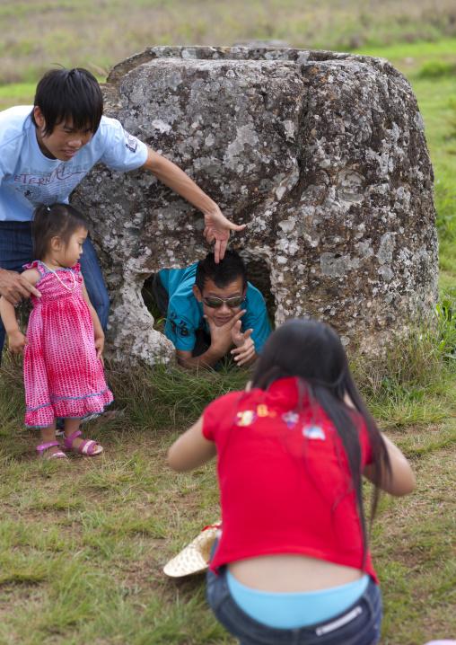 Tourists in the plain of jars, Phonsavan, Laos