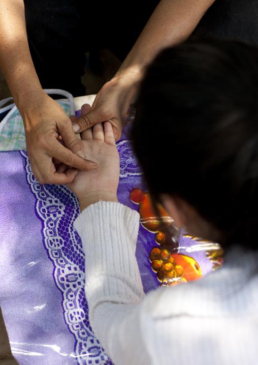 Hand divination in the street, Vientiane, Laos
