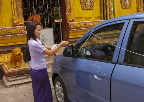 Baci ceremony for a new car in vat si muang, Vientiane, Laos