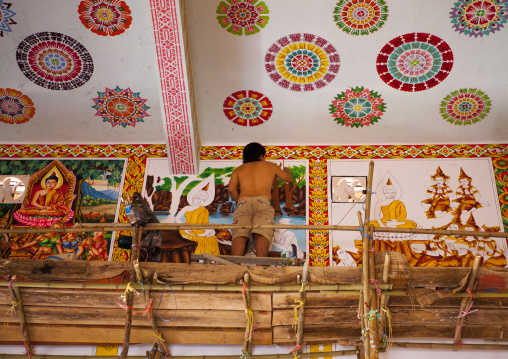 Man painting in a temple, Vientiane, Laos