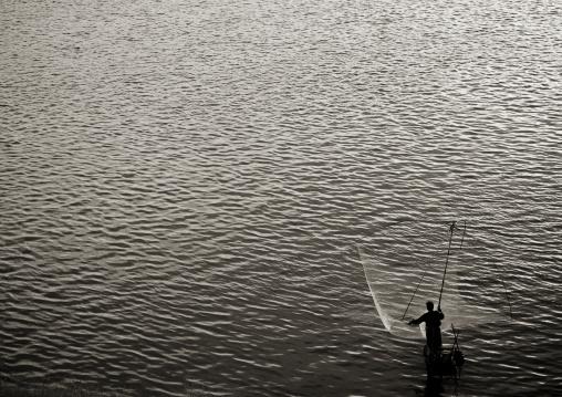 Fisherman on mekong river, Thakhek, Laos