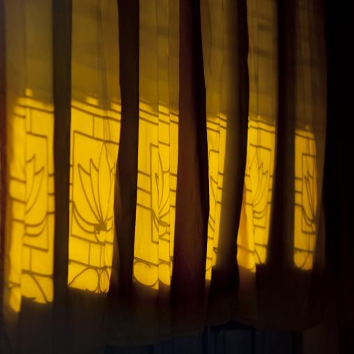 Curtains in front of a window, Savannakhet, Laos