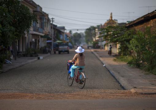 Girl on abicycle, Savannakhet, Laos