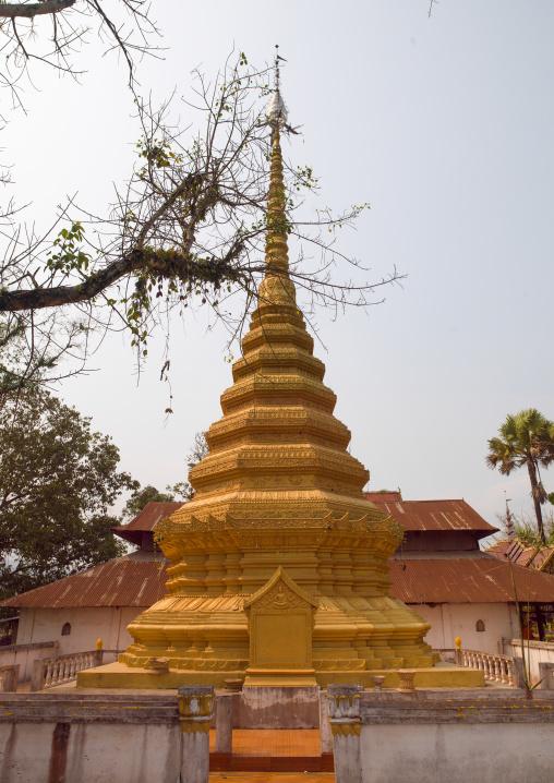 Buddhist gold covered stupa, Nam deng, Laos