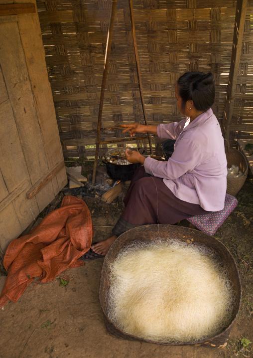 Woman in a silk factory, Louang namtha, Laos