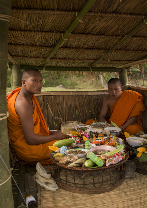 Monks during a death ceremony, Phonsavan, Laos