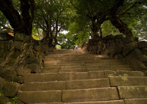 People climbing stairs at wat phu khmer temple, Champasak, Laos