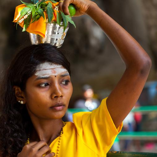 Hindu Devotee Woman Carrying Water Jug On Her Head In Annual Thaipusam Religious Festival In Batu Caves, Southeast Asia, Kuala Lumpur, Malaysia