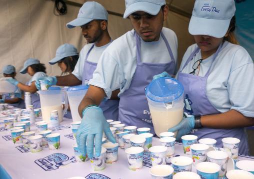 Free Milk Distribution During Annual Thaipusam Religious Festival In Batu Caves, Southeast Asia, Kuala Lumpur, Malaysia