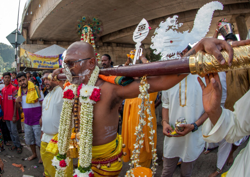Hindu Devotee With A Metallic Mask In Annual Thaipusam Religious Festival In Batu Caves, Southeast Asia, Kuala Lumpur, Malaysia