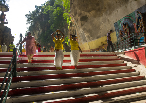Hindu Devotees On Stairs With Water Jugs On Their Heads In Annual Thaipusam Religious Festival In Batu Caves, Southeast Asia, Kuala Lumpur, Malaysia
