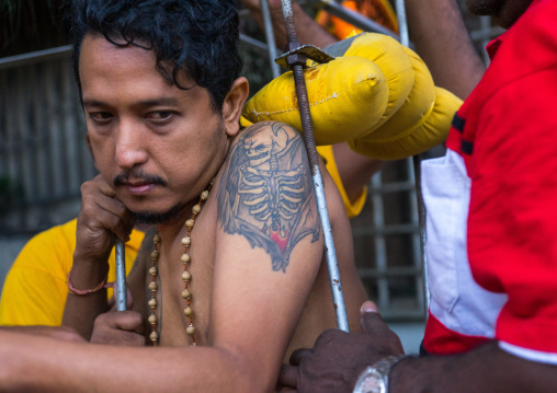 Tired Hindu Devotee With Tattoo On His Shoulder In Annual Thaipusam Religious Festival In Batu Caves, Southeast Asia, Kuala Lumpur, Malaysia
