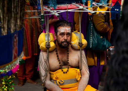 Hindu Devotee In Annual Thaipusam Religious Festival In Batu Caves Resting With His Kavadi On The Shoulders, Southeast Asia, Kuala Lumpur, Malaysia