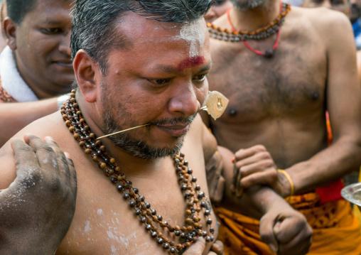 Hindu Devotee With Pierced Tongue During Annual Thaipusam Religious Festival In Batu Caves, Southeast Asia, Kuala Lumpur, Malaysia