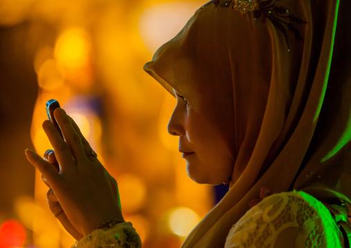 Muslim Woman In Annual Thaipusam Hindu Religious Festival In Batu Caves Taking Pictures, Southeast Asia, Kuala Lumpur, Malaysia
