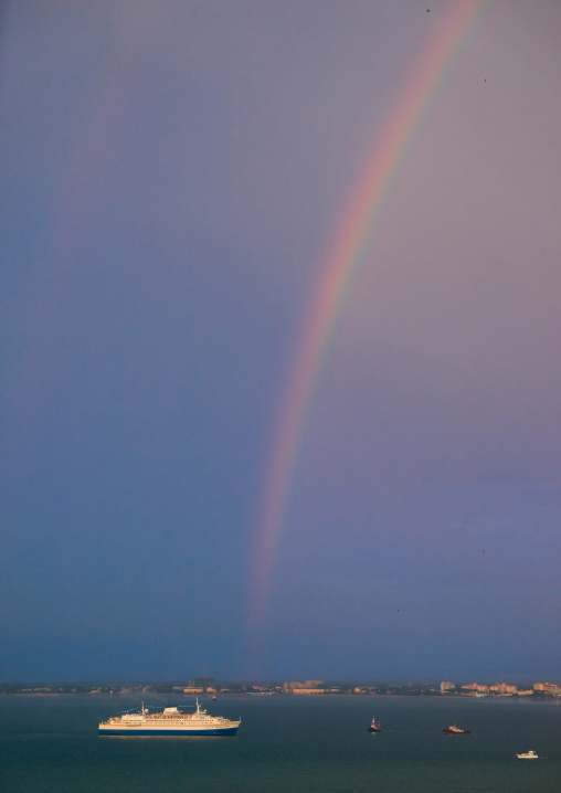 Cruise Boat In Front Of A Rainbow On The Sea, Penang Island, George Town, Malaysia