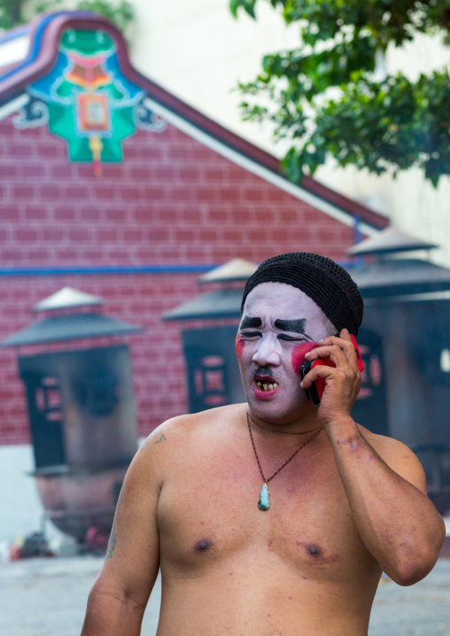 Chinese Opera Actor Making A Call On Mobile Phone At Goddess Of Mercy Temple, Penang Island, George Town, Malaysia