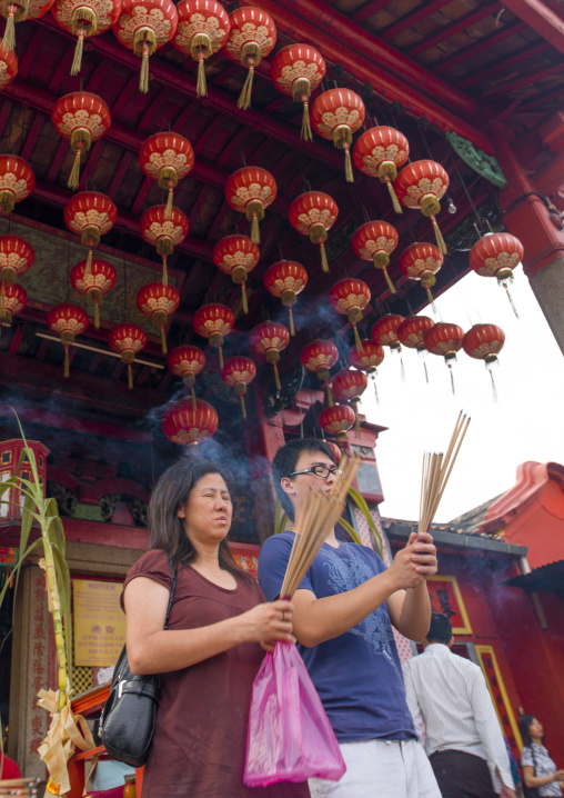 People Praying In A Temple Under Lanterns, George Town, Penang, Malaysia