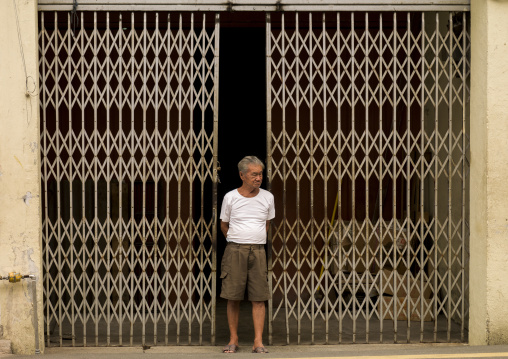 Man In Front Of A Closed Shop, Malacca, Malaysia