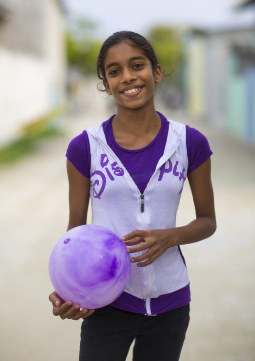 Young Girl With A Ball, Eydhafushi, Baa Atoll, Maldives