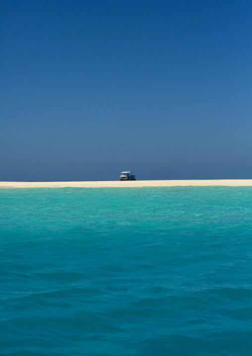Yacht In Front Of A Beach In Soneva Fushi Resort, Baa Atoll, Maldives