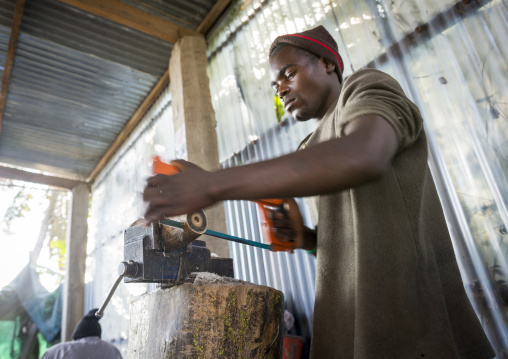 Man Making Jewels With Cow Horn, Maputo, Maputo City, Mozambique