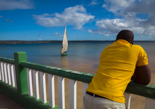 Man Looking At A Dhow In The Bay, Inhambane, Inhambane Province, Mozambique