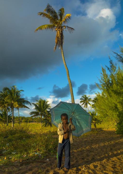 Boy With An Umbrella In The Country, Inhambane, Inhambane Province, Mozambique