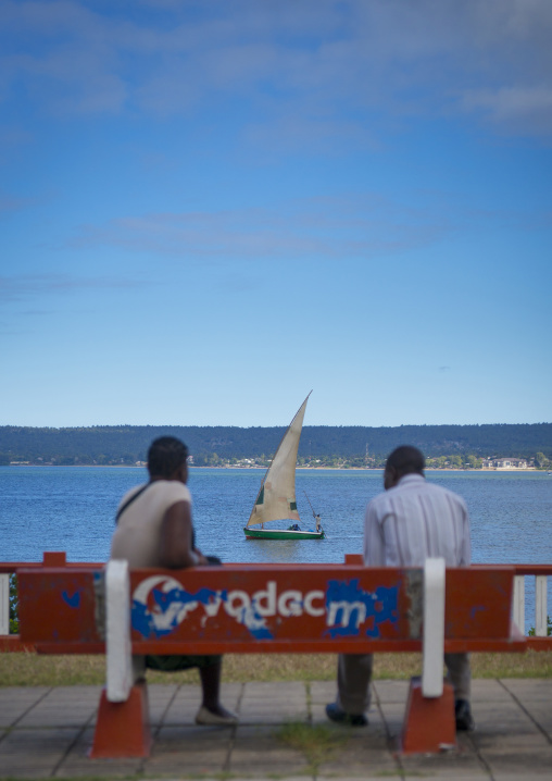 Couple On A Bench Looking At A Dhow, Inhambane, Inhambane Province, Mozambique