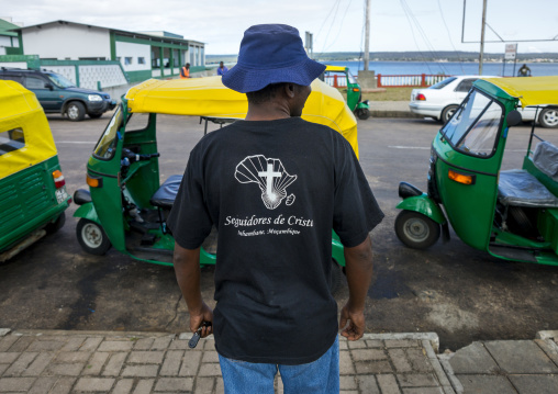 Man With A Christian Tshirt In Front Of Taxis, Inhambane, Inhambane Province, Mozambique