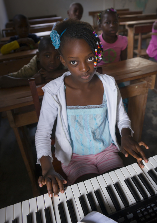 Girl Playing Music In A School, Inhambane, Inhambane Province, Mozambique