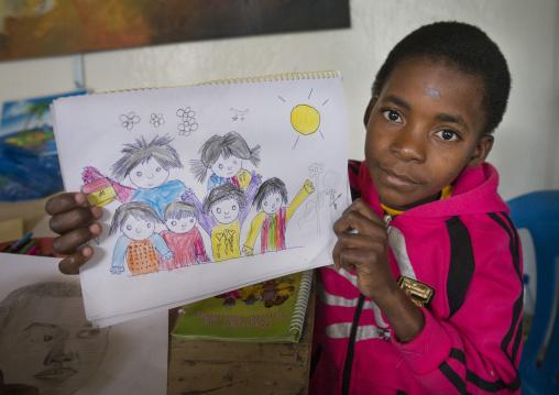 Boy Showing A Drawing In A School, Inhambane, Inhambane Province, Mozambique