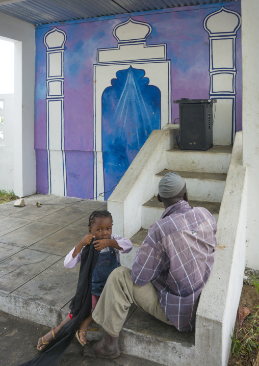 Father and daughter in front of a mosque, Inhambane Province, Mozambique