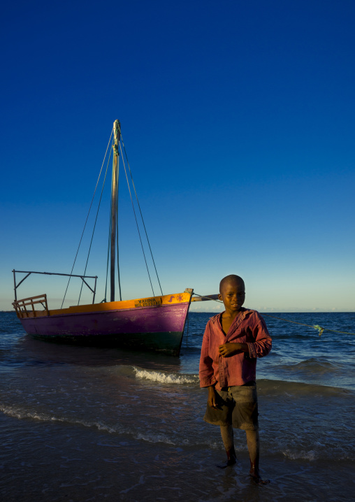 Kid In Front Of A Dhow On The Beach, Vilanculos, Inhambane province, Mozambique