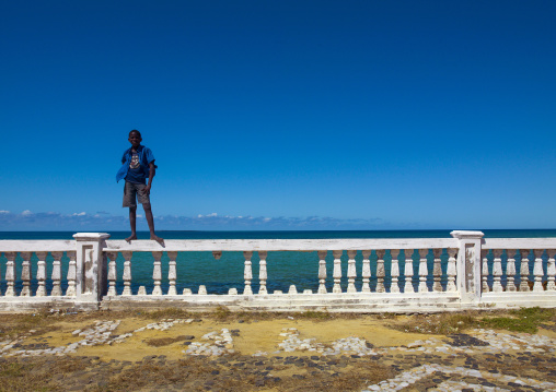 Kid Standing On A Fence, Ilha de Mocambique, Nampula Province, Mozambique