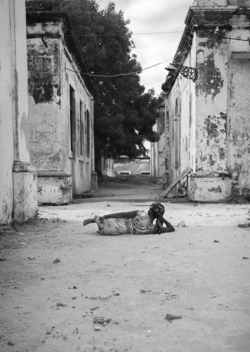 Woman Lying On The Ground Inside The Old Hospital, Ilha de Mocambique, Nampula Province, Mozambique