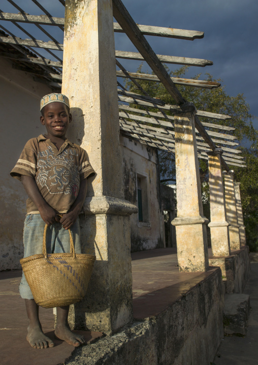 Kid Standing In Front Of An Old Portuguese Colonial House, Ibo Island, Cabo Delgado Province, Mozambique