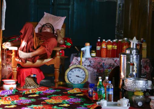Buddhist Monk Sleeping In Nga Phae Kyaung, Inle Lake Jumping Cats Monastery Myanmar